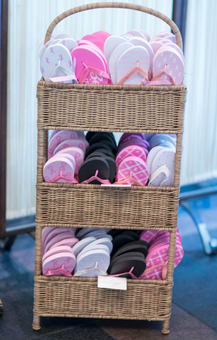 Flip flops kept guests dancing comfortably throughout the reception, and the pink, white and black patterns brought the color palette to the dance floor.