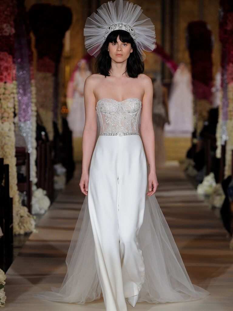 Reem Acra Spring 2020 Bridal Collection bridal jumpsuit with corseted bodice and long tulle train