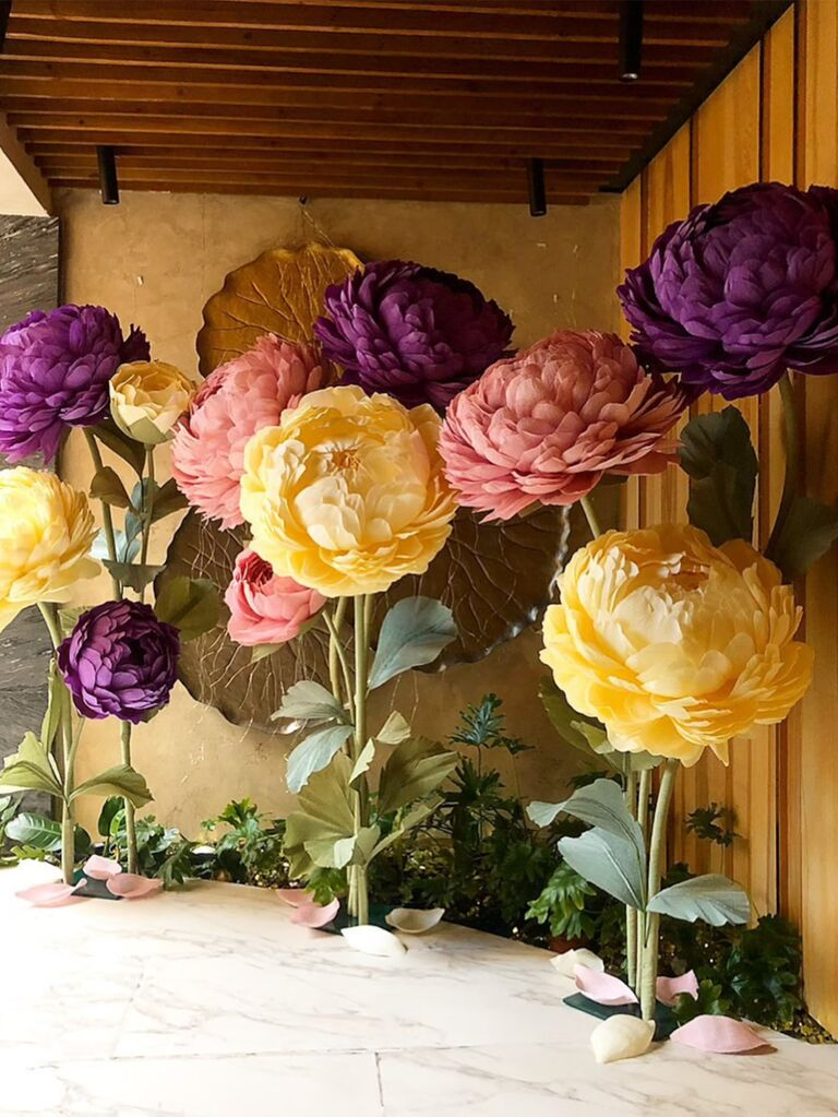 Large paper flowers in yellow, pink and purple