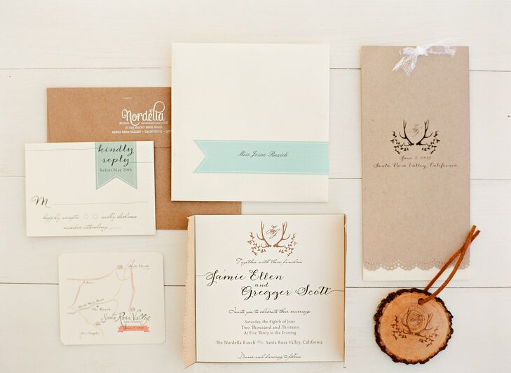 Jamie, a graphic designer, designed all of the wedding's stationery herself. To create a rustic, romantic look Jamie incorporated elements like kraft paper, lace, wood, calligraphy and water colors into the invitation suite. She also designed a custom stamp with antlers, a wreath and the couple's monogram that she stamped on each of the invitations.