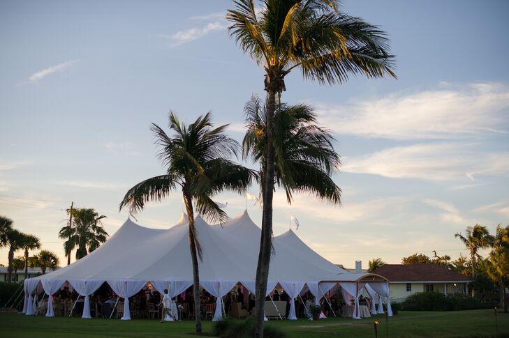 After the ceremony, Emily and Jason joined their guests for dinner and dancing under an expansive open-air tent that offered fantastic views of the surrounding palm trees and the crystal blue waters beyond Gasparilla Inn & Club in Boca Grande, Florida.