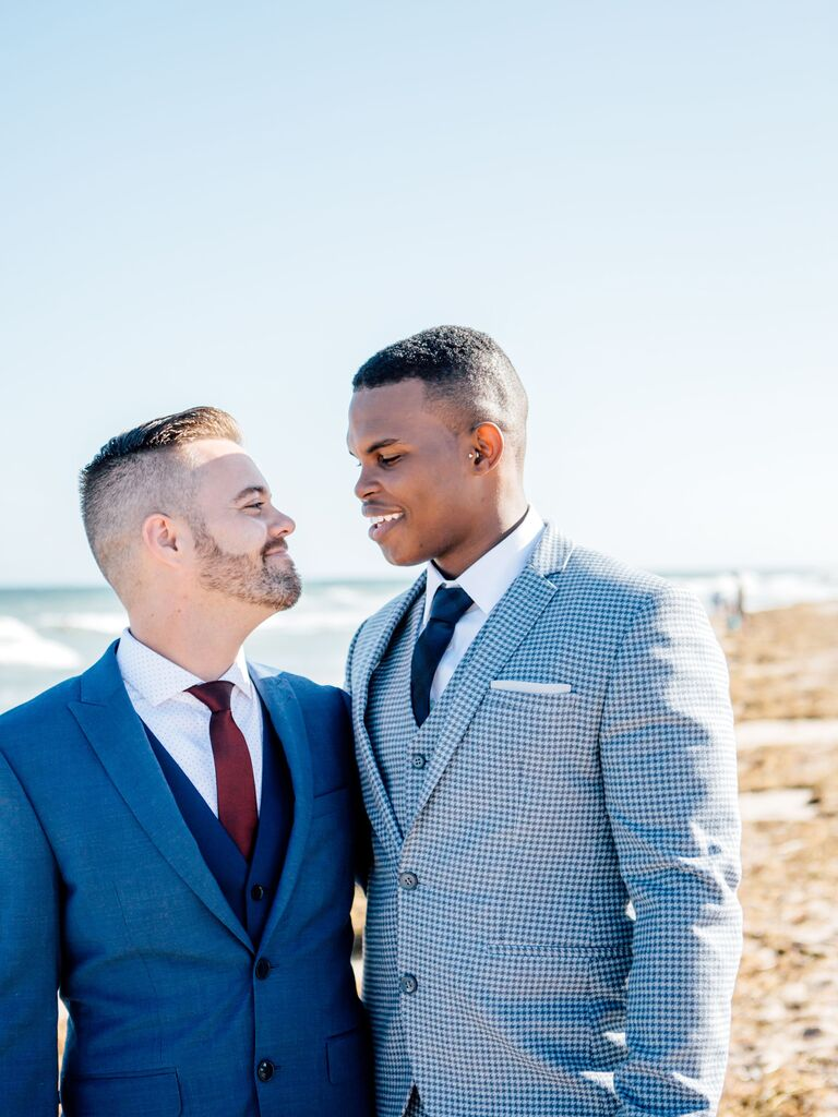 Grooms smiling at each other