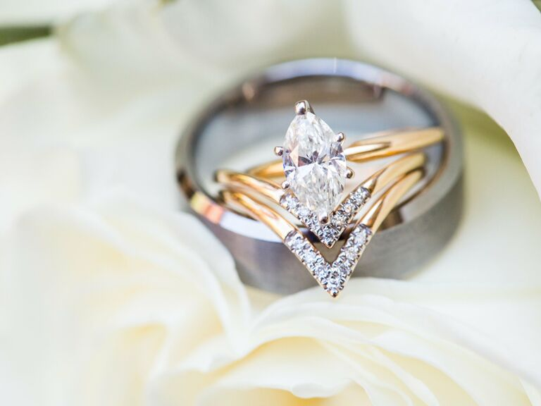 Oval engagement ring with chevron diamond bands and mens band