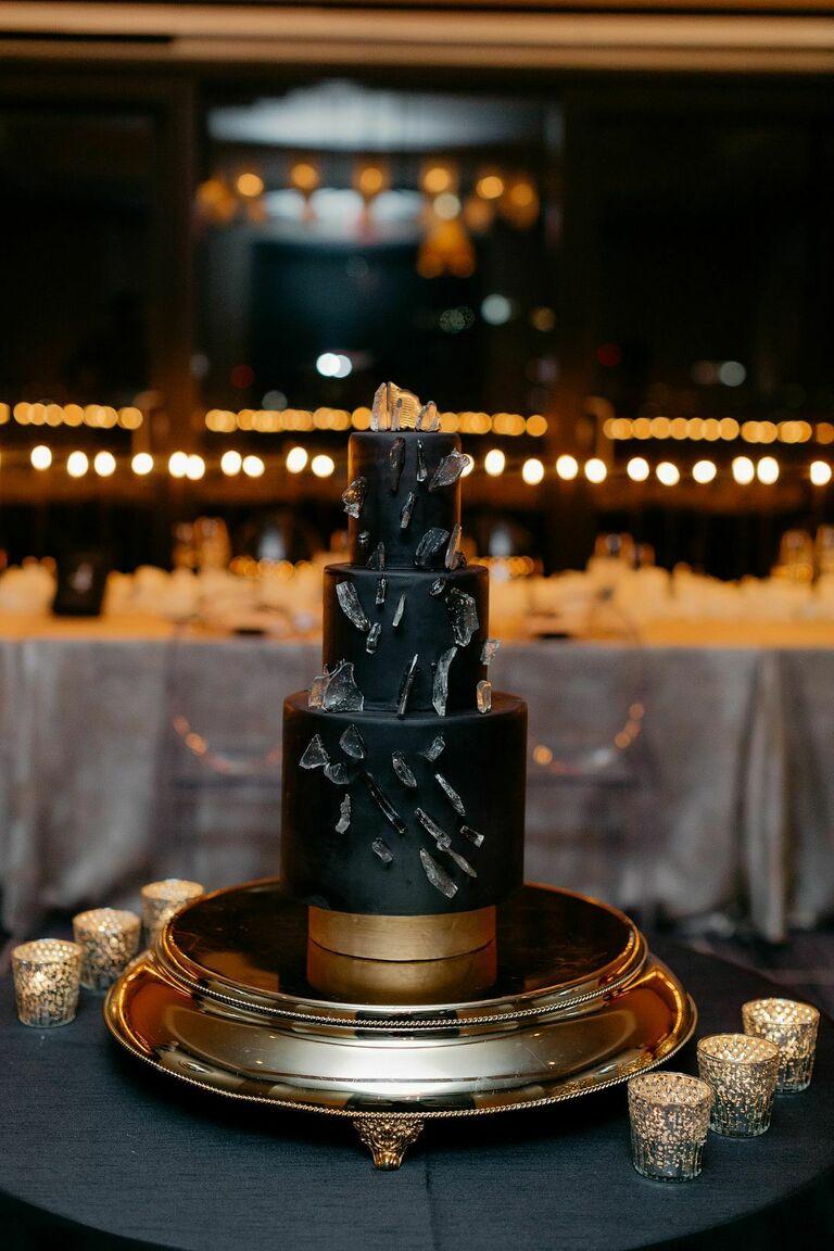 Three-tier modern black wedding cake with sugar shard decorations