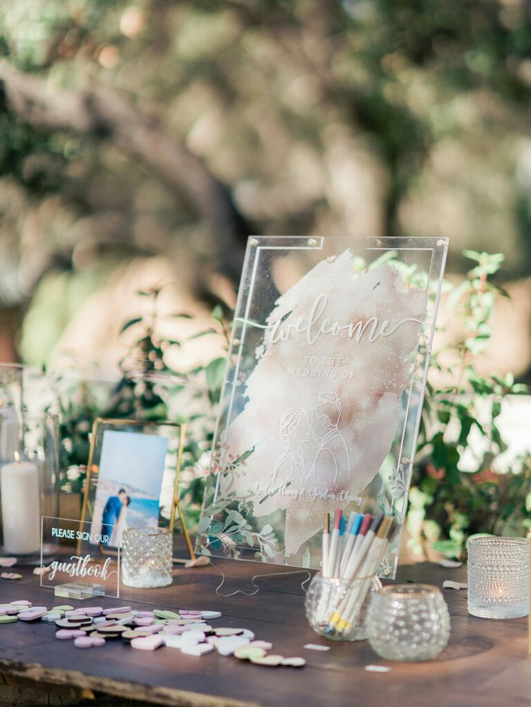 Acrylic wedding hashtag sign on guest book table