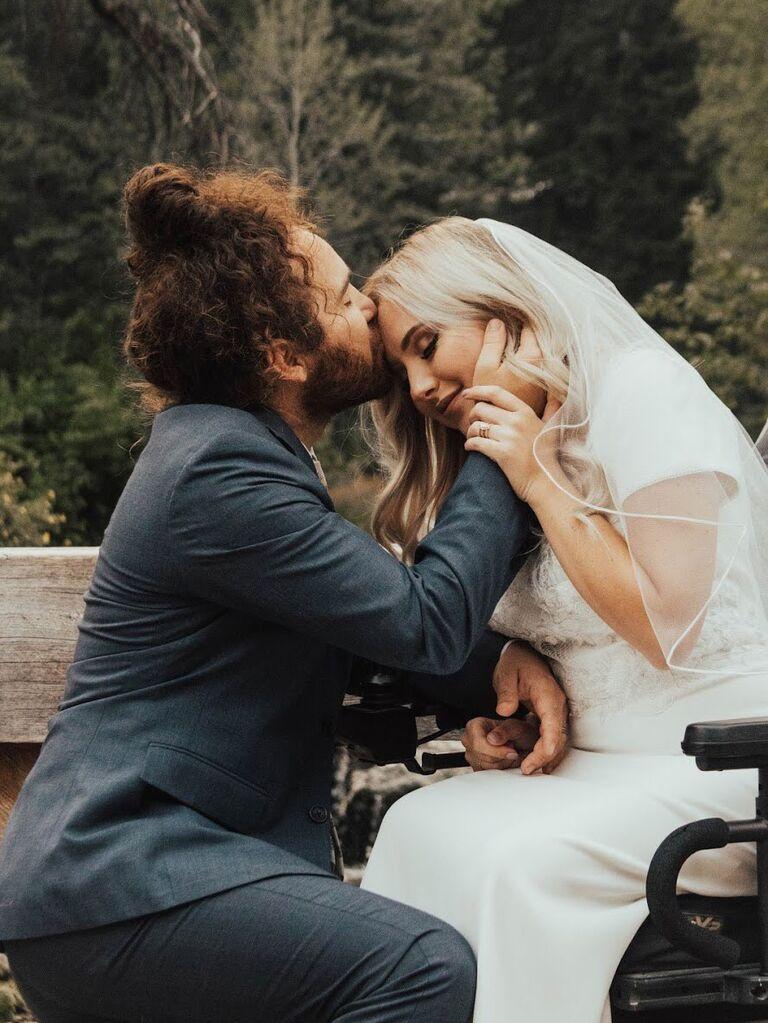 Couple kissing forehead