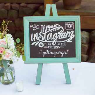 Chalkboard sign for Instagram wedding hashtag