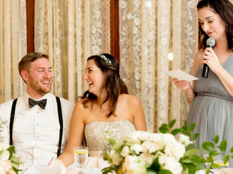 Maid of honor giving bridesmaid speech for newlywed couple