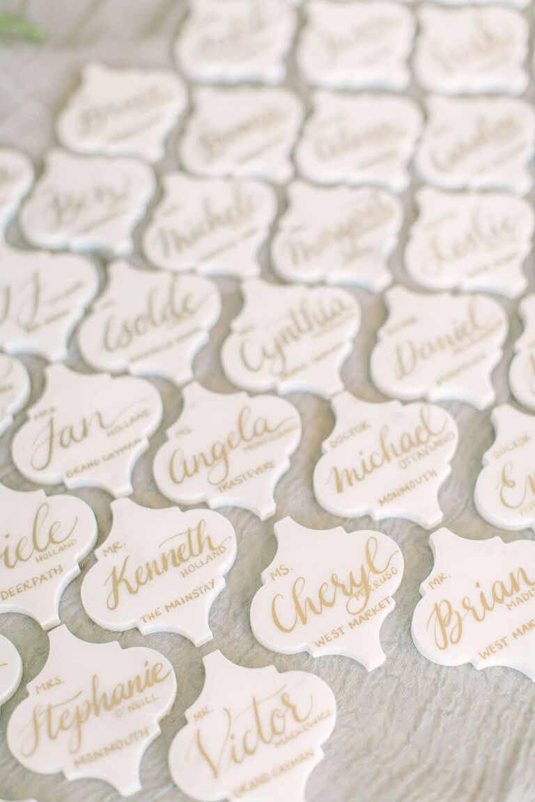 Calligraphed marble tile escort cards