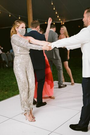 Bride Dancing in Sparkly Silver Jumpsuit