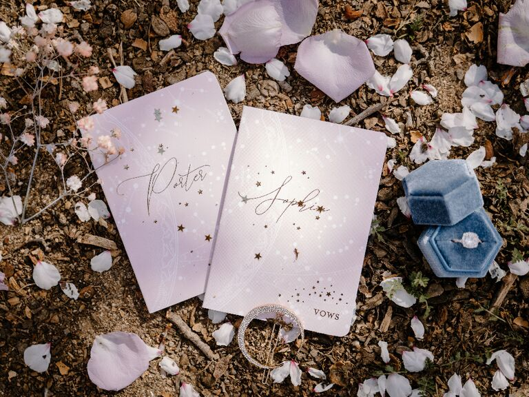 Light pink wedding vow books with celestial-themed star print