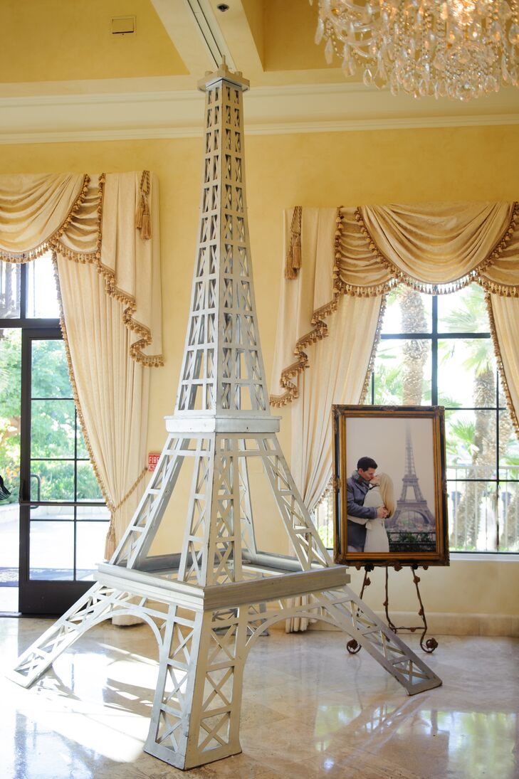 A model Eiffel Tower was available for guests to take pictures in front of. This piece was important to the couple because during one of their vacation trips, they stopped quickly at the Eiffel Tower and took engagement photos (with one displayed in the back).