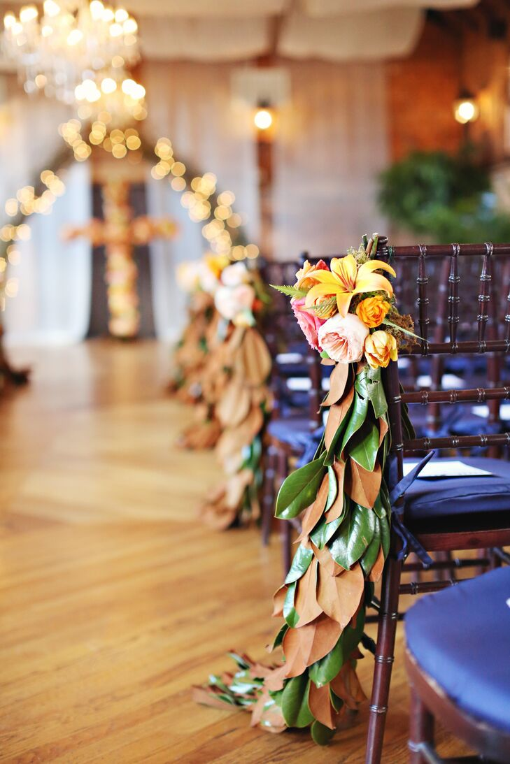 Magnolia garlands were attached to the ceremony chairs with petite orange garden roses and cascaded to the floor.