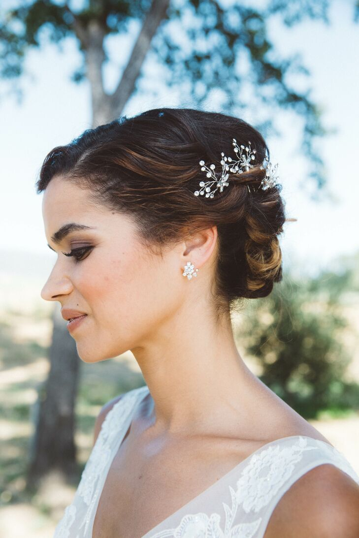 Claire accessorized her illusion ball gown with jeweled studs and an intricate hairpiece to match.