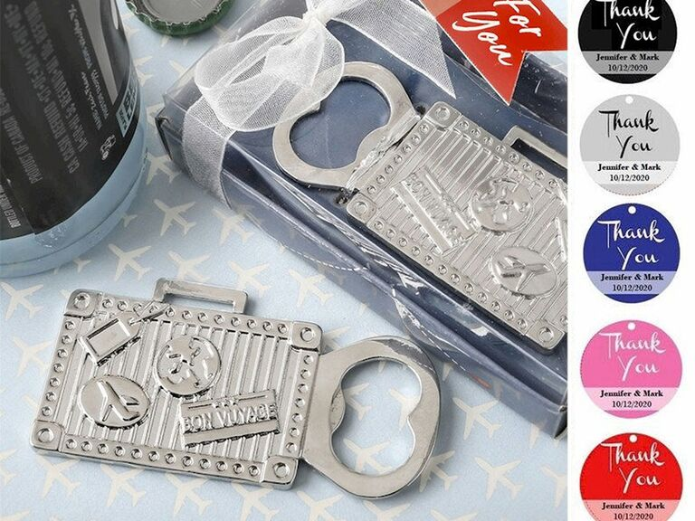 Silver bottle opener in suitcase shape with 'Bon voyage' and other travel-related graphics