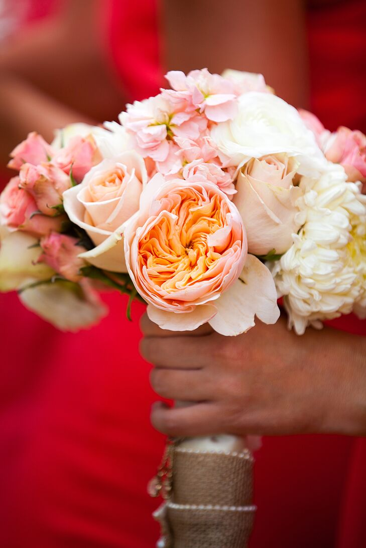 """""""The girls' flowers were peach and coral flowers with white,"""" Veronica says. """"Each of their bouquets had a meaningful charm that we put on together before the wedding."""""""