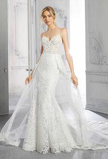 bride twirling in airy wedding dress