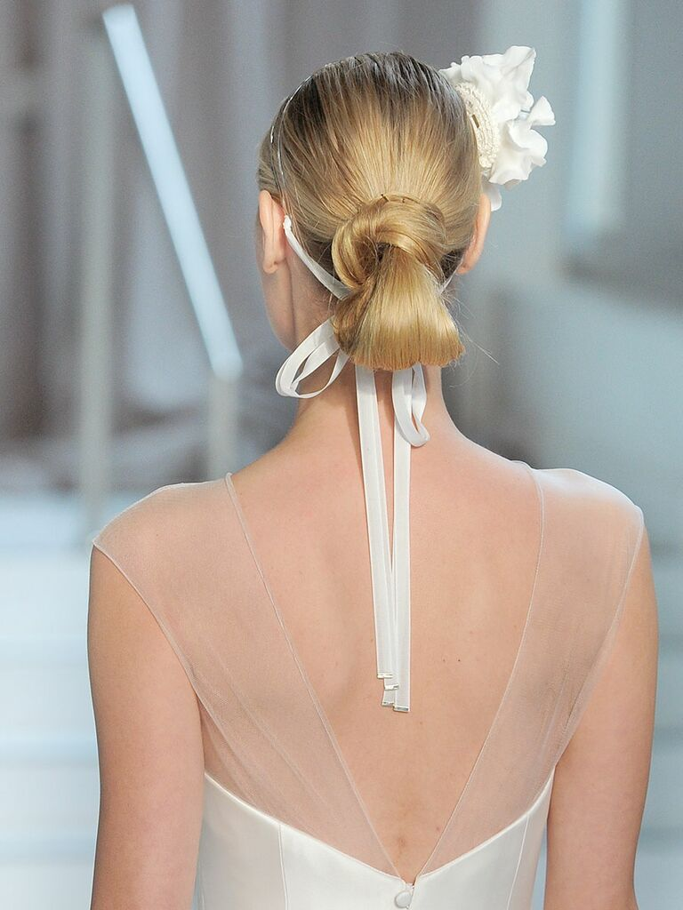 Modern low bun hairstyle for a chic wedding look