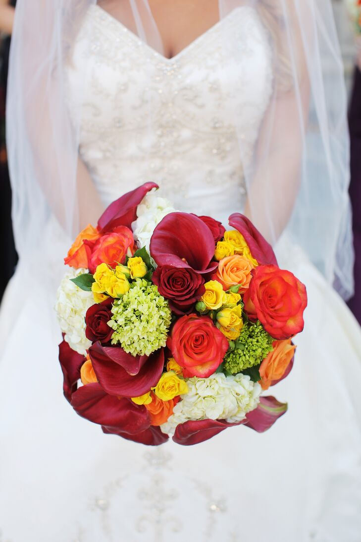 Now this bouquet looks like a rainbow! Michelle had her favorite white hydrangeas paired with wine-colored calla lilies, yellow spray roses, mini green hydrangeas and tons of roses in red, orange and pink. To make it even more personal, each stem was gathered in a rosary from her godfather's late wife.