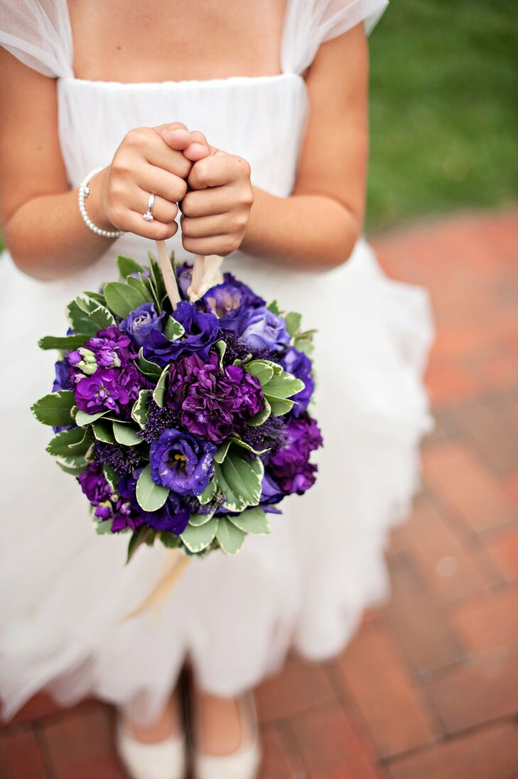 The flower girl carried a pomander of purple stock, lisianthus and trachelium.