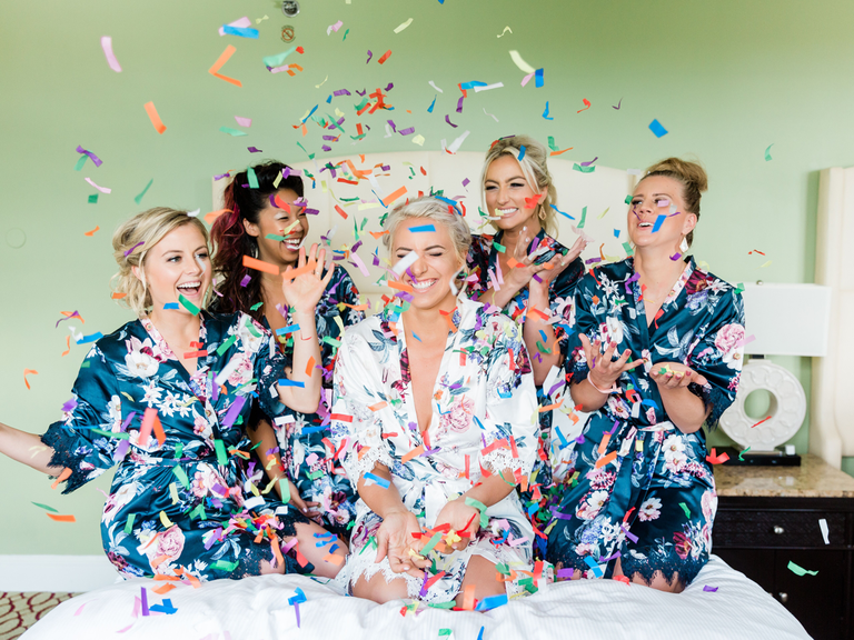 getting ready timeline wedding bridesmaids and bride with confetti