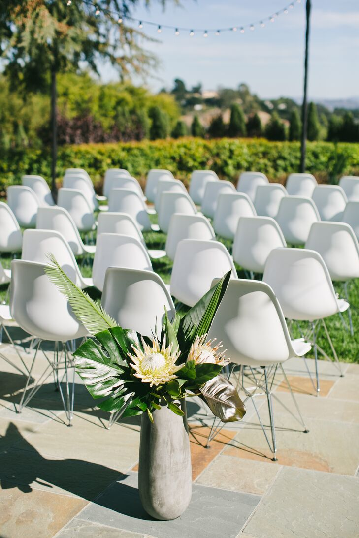 White Eames-style chairs were used at the ceremony and doubled as seating at the reception at Scott's parents' home in San Rafael, California.