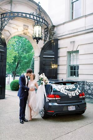 Couple With Just Married Car Decorations
