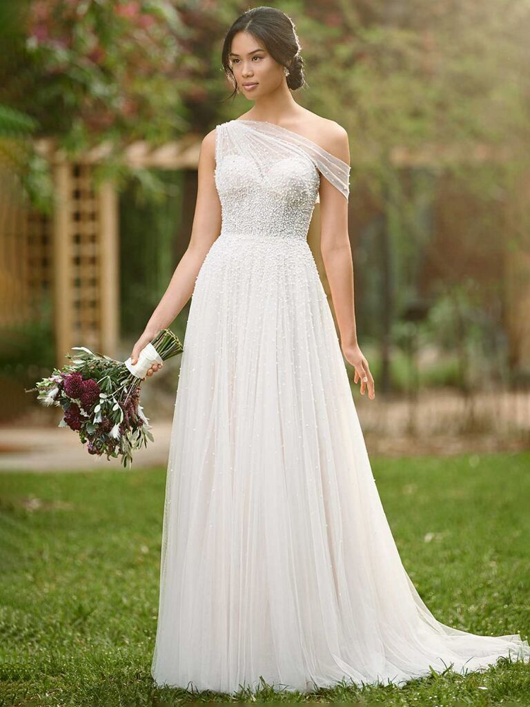 essense of australia white a line wedding dress with one shoulder mesh sleeve sweetheart neckline beading and flowy pleated skirt