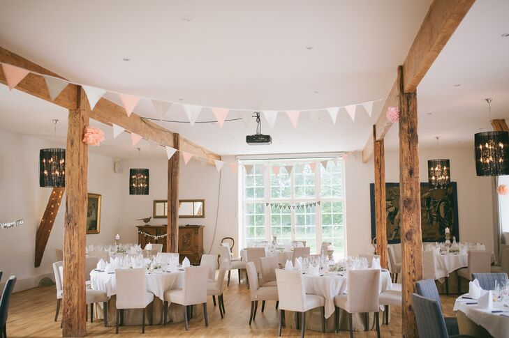 """""""Since we wanted a countryside wedding, we decided to have the reception at Elisefarm Golf Course in an newly renovated old barn with nice beams and a high ceiling,"""" Victor says. """"The surroundings were just amazing with such a beautiful nature and lake view."""""""