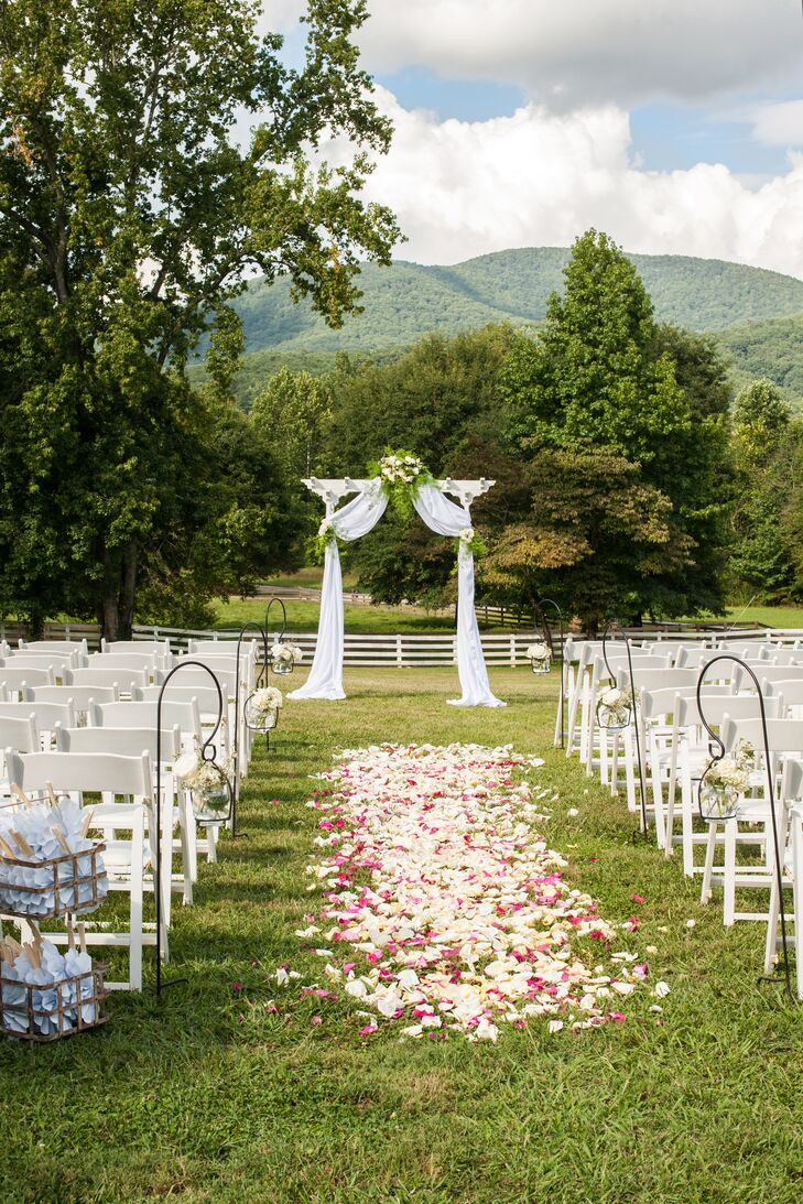 The Ruins at Kellum Valley Farms offered Cole and Sarah Beth nine different locations for the ceremony and reception. The couple chose to host the ceremony on the venue's expansive lawn, which overlooked the lush green forests and mountains in the distance.