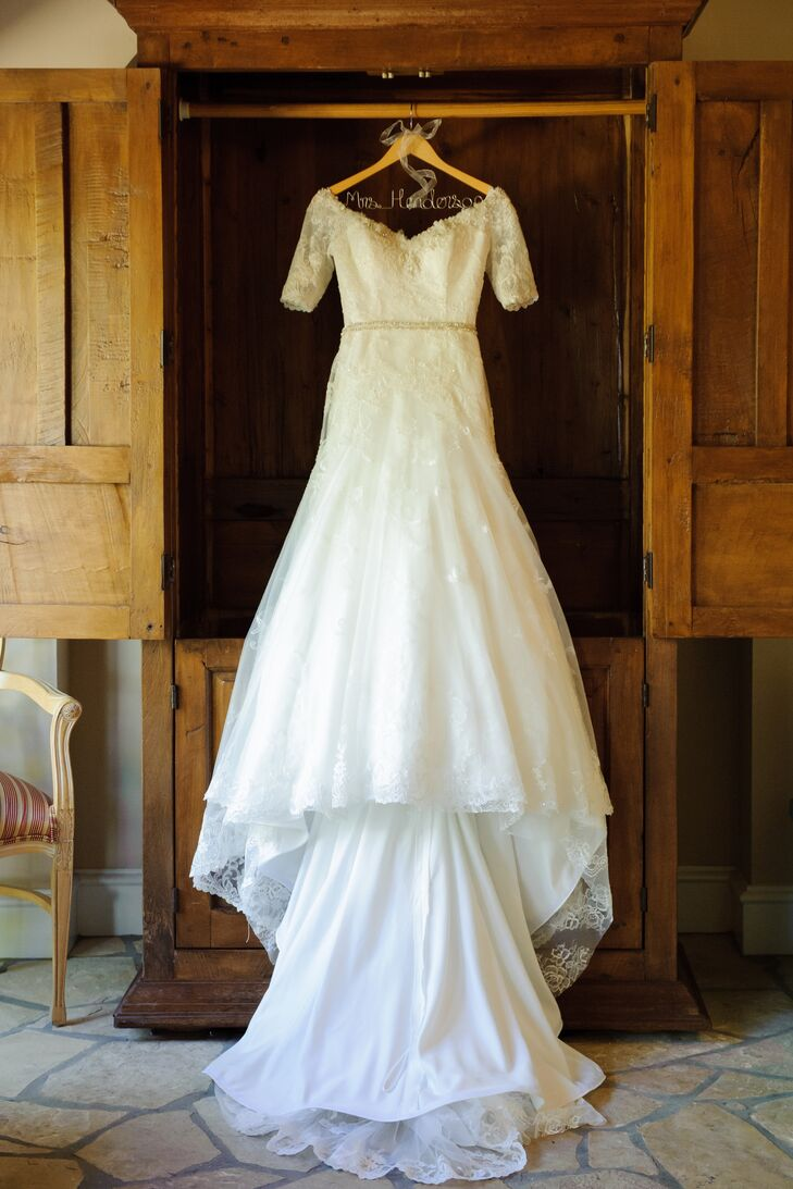 Jill wore an elegant off-the-shoulder, A-line wedding dress, which had a bodice and skirt overlay accented in lace. The dress's long train trailed behind Jill throughout the day.