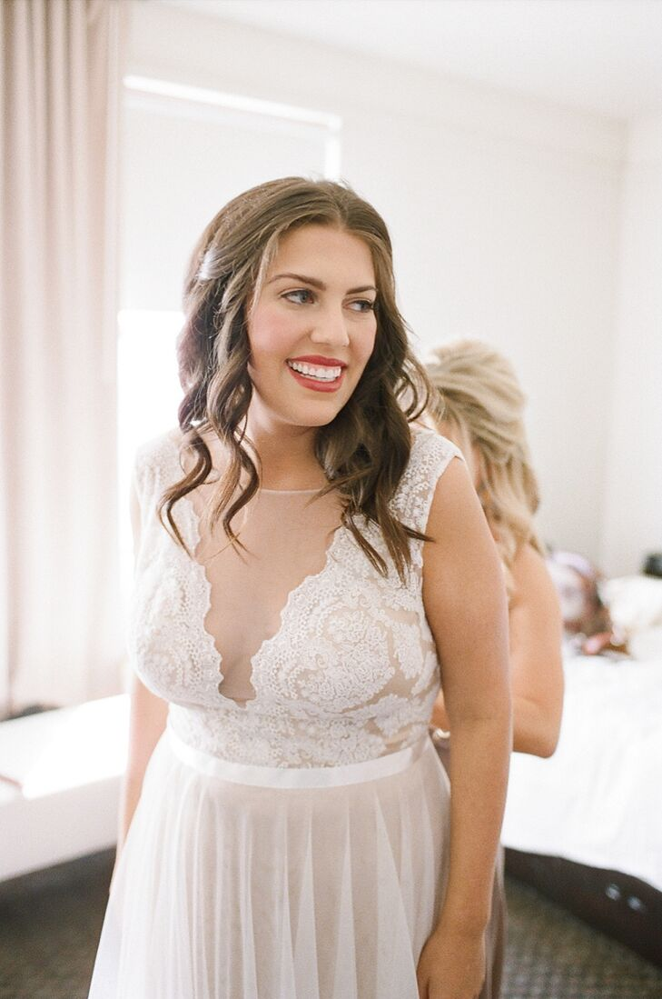 """When wedding dress shopping with her mom, Marissa walked inside Brickhouse Bridal and told the attendant she wanted to try on the Watters Santina dress, """"and that is the dress I wore on my wedding day."""" Details include an illusion neckline, plunging back, covered buttons, hand-placed lace, satin ribbon and an amaretto lining under nude-colored tulle and ivory lace."""
