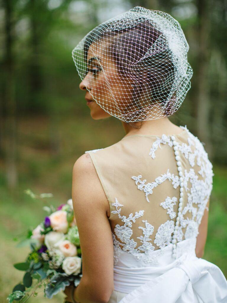 Bride wearing vintage birdcage veil