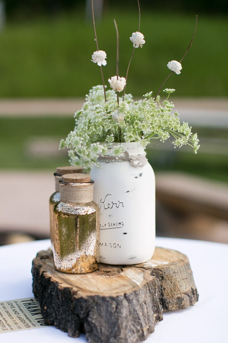 Mason jars were painted white and filled with wildflowers to create these rustic, DIY centerpieces.