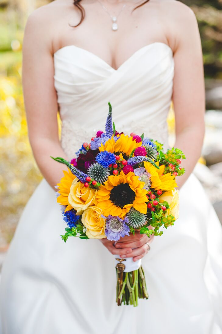 Kimberly carried sunflowers, scabies, hypericum berries, roses and Veronica in her bouquet for a colorful wildflower look.