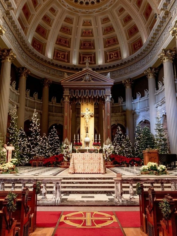 Church decorated with Christmas trees