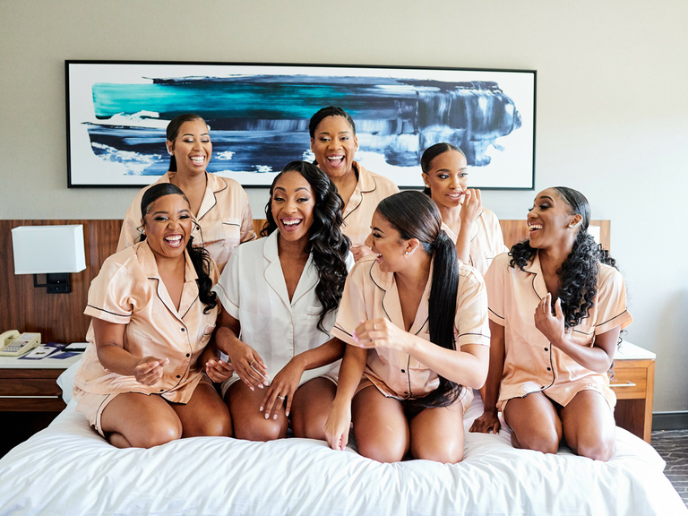 getting ready timeline wedding bride with bridesmaids laughing