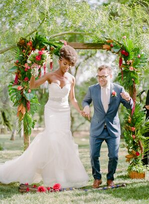 Couple Jumping the Broom at Outdoor Ceremony