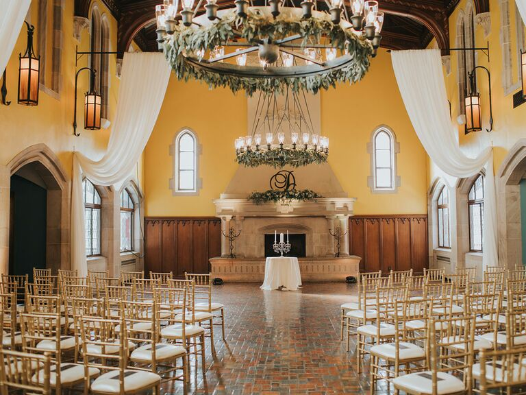 Indoor wedding ceremony with floral altar