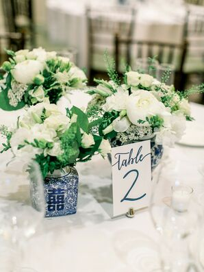 Blue-and-White Chinoiserie Vases with White Roses and Table Numbers at Wedding Reception Tables