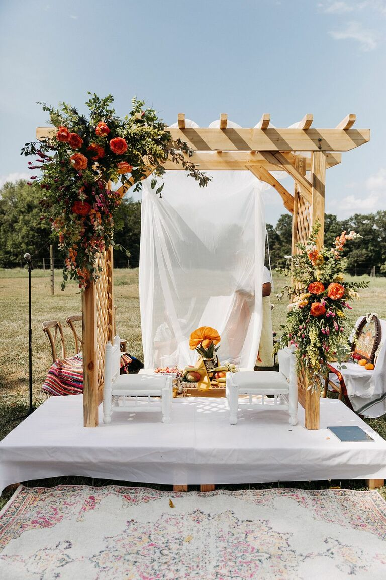 Wood pergola turned into rustic mandap with flowers