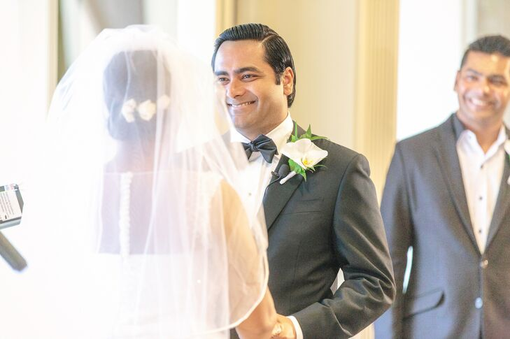 Classic Groom with Bow Tie and Orchid Boutonniere