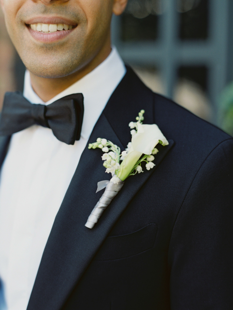 Boutonniere with calla lily and lilies of the valley