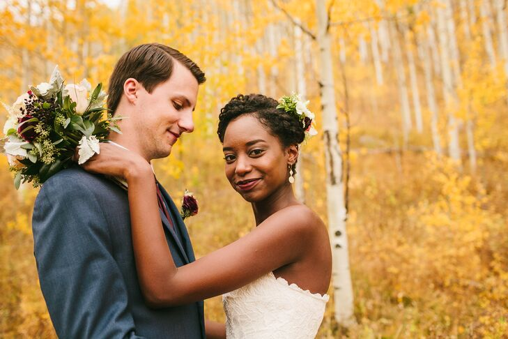 Natural Couple Among Aspen Trees in Fall