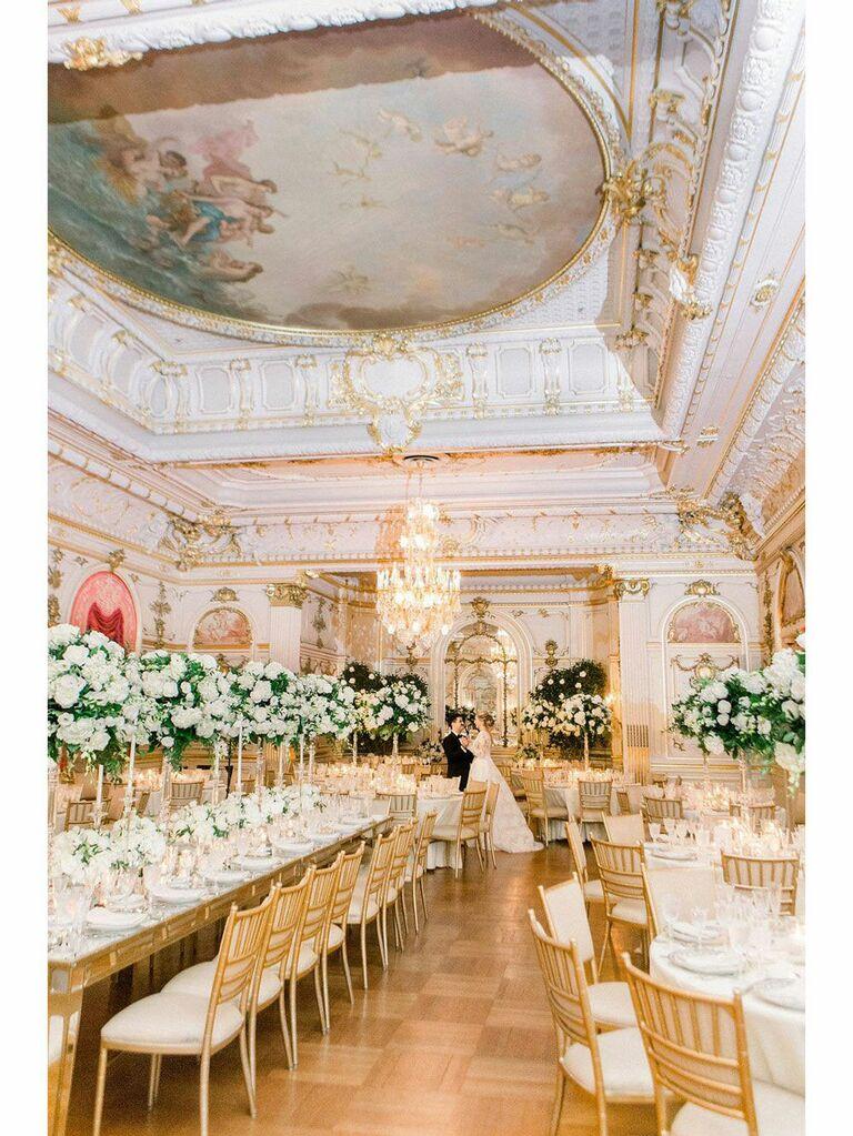 Bride and groom posing in opulent regencycore wedding venue