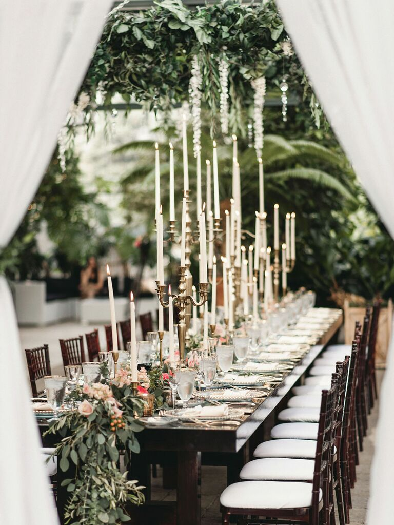 Romantic wedding theme with long reception tables and long candlesticks