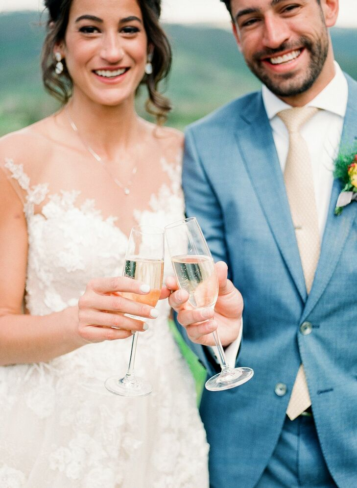Couple Toasting with Champagne During Colorado Wedding