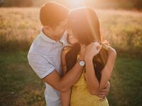 Outdoor engagement photo shoot at sunset