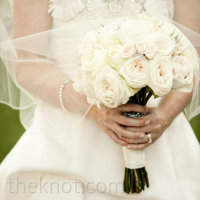 Terren carried a bouquet of lush white and ivory garden and Polo roses.