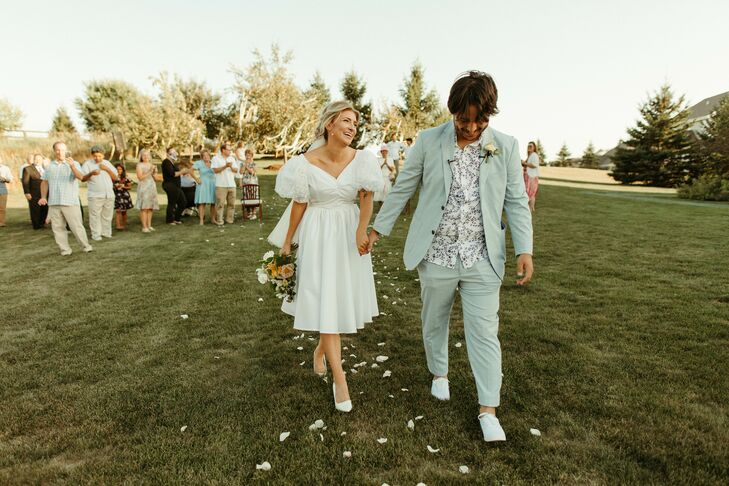 Vintage-Style Couple Recessing Down the Wedding Aisle